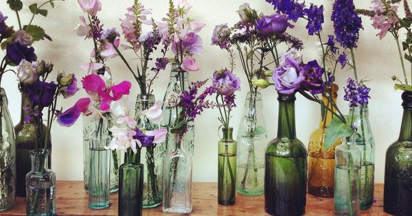 assorted sized vintage glass bottles for wild flower arrangments.