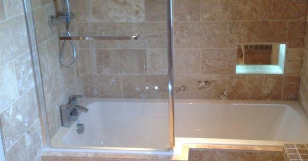 We love the brown granite tiling alongside the bath panel for Bathroom design grimsby