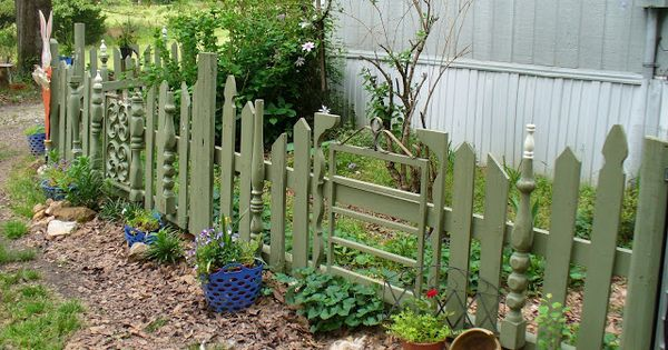 Adorable Mismatched Garden Fence From Recycled Parts