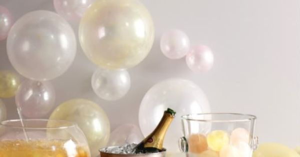 Balloons on the wall look like bubbles party ideas for Champagne balloon wall