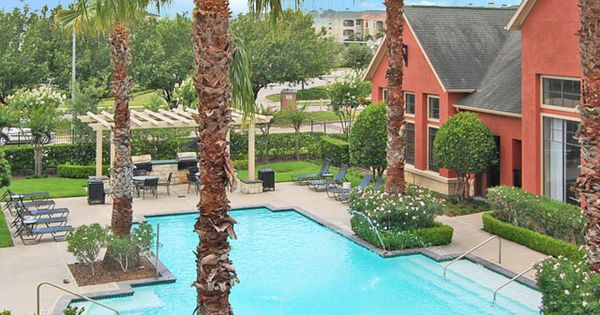 The Retreat At Eldridge Apartments Pool Surrounded By Tall