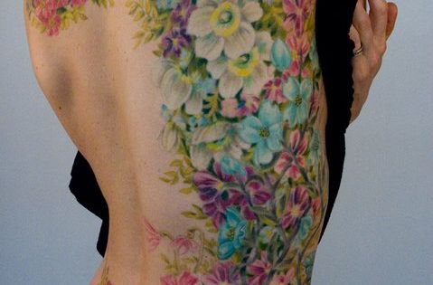 Orchid Tattoo Design. Contact us for more information on how to become