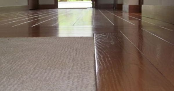 Low pile carpeting recessed into wood floors completes for Wood flooring retailers