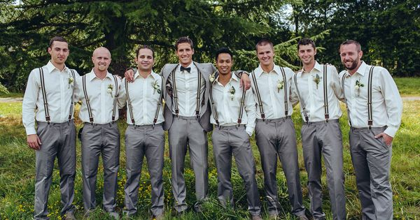 To match the groom in his gray suit, groomsmen wore gray pants,