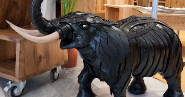 How to recycle creative sculpture made from old tires for Old tire art