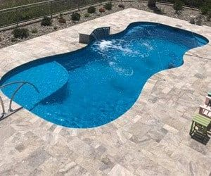 The New Coral Sea 31 Lounger Is A Perfect Pool For Smaller Backyards Small Backyard Pools Fiberglass Pool Cost Small Inground Pool