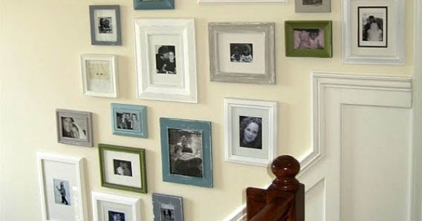 I'm liking the molding going up the stairs! Photo gallery walls. I