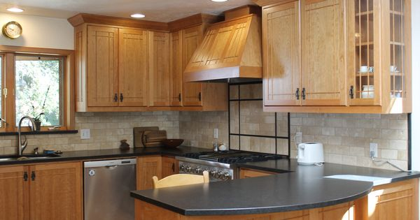 oak wood cabinetstogo with ventahoods and corian countertop for traditional kitchen design ...