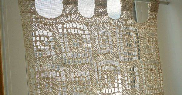 knitted lace curtains for lots of light and just a bit of privacy. Im pi...