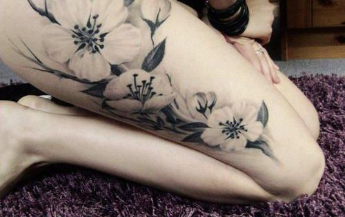 Black And White Flower Tattoo beautiful but i would prefer it on