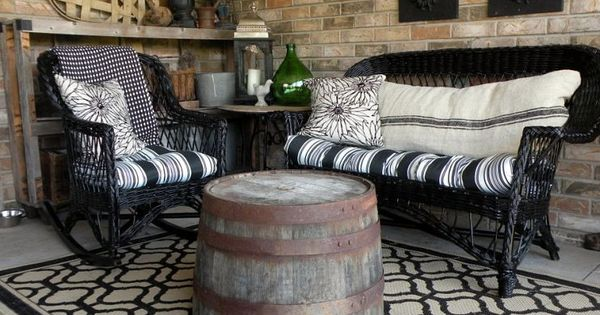 DIY spray paint wicker furniture + using half wine barrels as tables