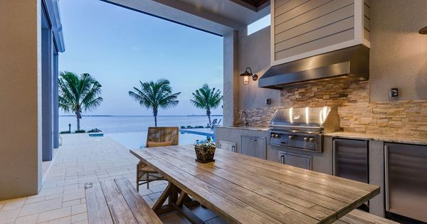 Custom Home Builder Cape Coral Fort Myers Fort Myers Beach Naples Marco Island Outdoor Kitchen Space Gr Custom Built Homes Home Builders Luxury Homes