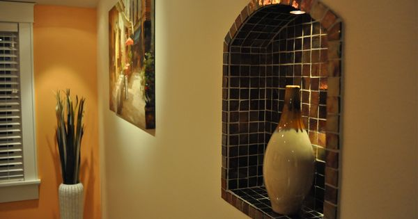Lighted wall niches stone tile interior waukesha for Decorating ideas for living room wall niche