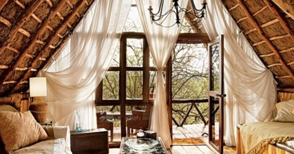 interior of a treehouse! love those curtains