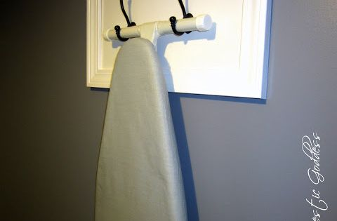 Way to hang ironing board in laundry room! Love it!