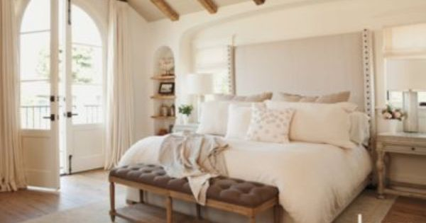 In the master bedroom, a serene and romantic space is created with