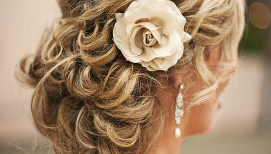 wedding updo I love flowers in the hair idea
