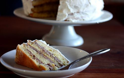 Cassata Cake. Rum-soaked sponge cakes are layered with cannoli filling ...