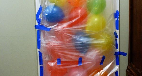 Birthday morning balloon avalanche once they open the door on the other