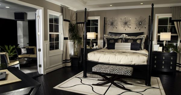 Elegant black and white bedroom design with splashes of zebra print (the