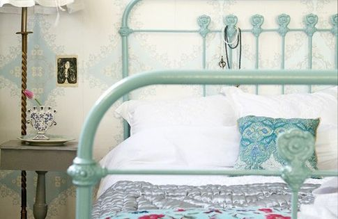 painted metal bed frame. that wallpaper is incredible along with the lamp