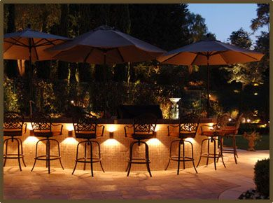 Fire In Backyard Want To Illuminate Your Outdoor Kitchen Pergola Or Your Entir Backyard Lighting Beautiful Outdoor Living Spaces Outdoor Landscape Lighting