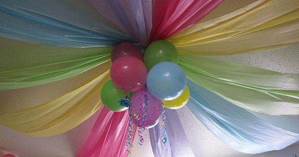 Dollar store plastic tablecloths for great decorations.. birthday party ideas