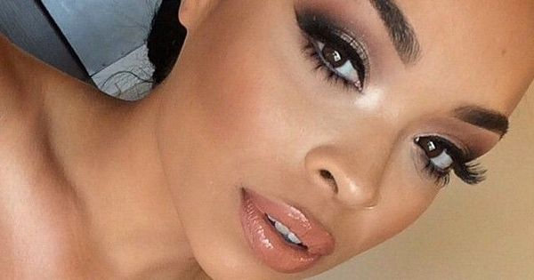 bridal makeup for brown skin with a peachy coral lip, false lashes ...