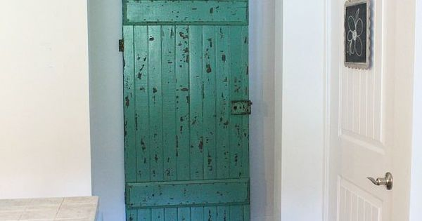 old barn door used as a sliding bathroom door