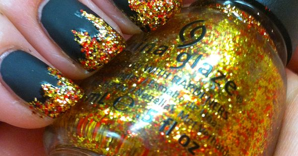 """THE HUNGER GAMES: """"Girl On Fire"""" inspired manicure! District 12 coal has"""