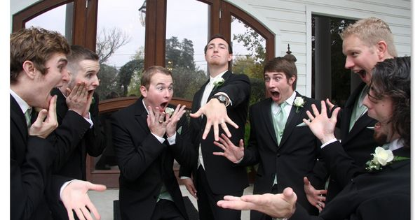 Aha, groomsmen fawning over the ring.