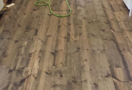 This is rustic 1x8 pine flooring stained with Minwax ...