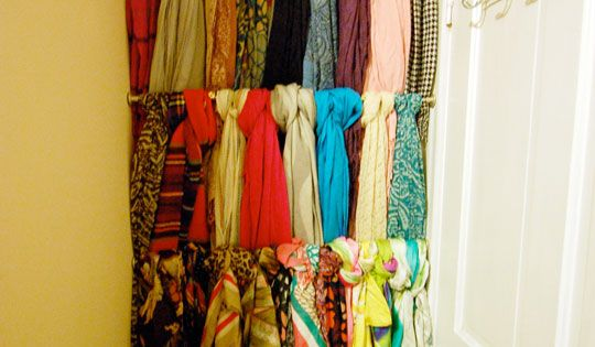 Streamlining Scarf Storage. Tension rods in the closet to hang scarves, belts,