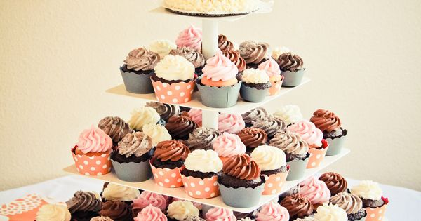 """""""Cupcakes! A small cake on top for just the bride and groom,"""