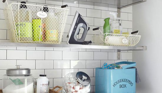Orderly Open Shelves: Three deep metal shelves hold a bevy of laundry