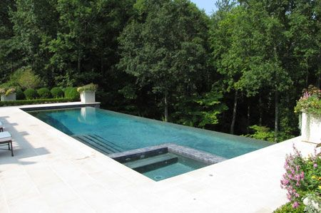 I Love How The Hot Tub Is Built In To The Pool The Infinity Edge Is Very Elegant And Sleek Swimming Pool Designs Infinity Pool Backyard Luxury Swimming Pools