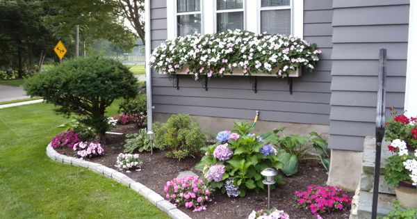 Corner flower bed landscaping design inspiration idea for Corner flower bed ideas