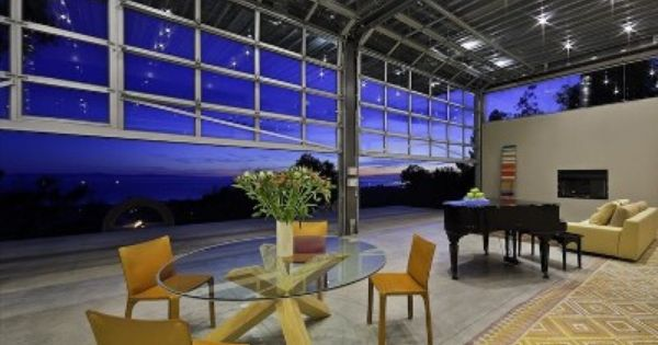Modern Vacation Rental Montecito Roll Up Doors Open Up The Pavilion And Views To The Sea Glass Garage Door Metal Building Homes Building A House
