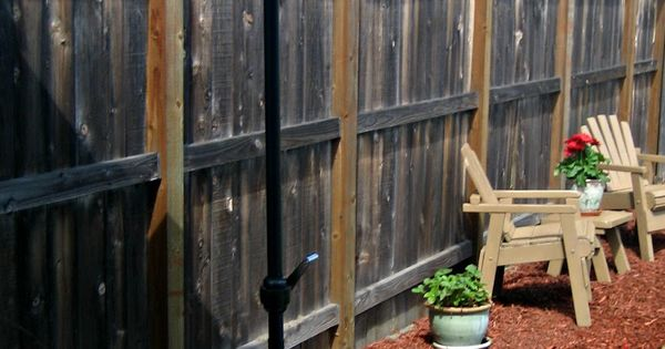 DIY Umbrella Stand... wine barrel planter plants