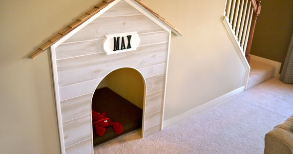 Use the dead space under stairs for a built in doghouse or