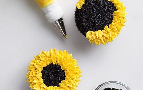 Piped Buttercream Sunflower Cupcake with chocolate covered sunflower seeds