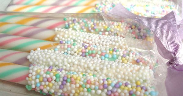 Candy sticks dipped in chocolate then sprinkles. Pretty & easy party favor
