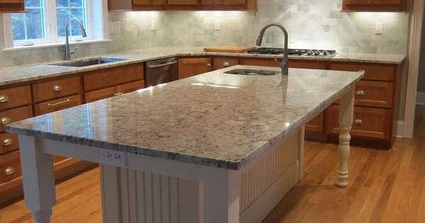 White Kitchen Island With Granite Countertop And Prep Sink Island Seating For 6 People At Bar