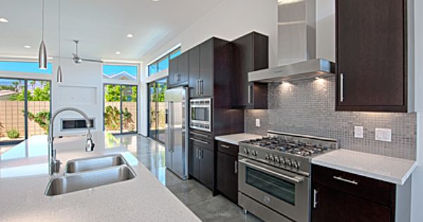 Espresso cabinets gray tile flooring white countertops for Chocolate kitchen cabinets with stainless steel appliances