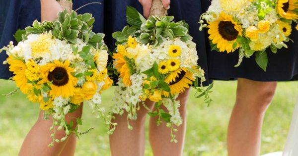 Navy bridesmaids dresses + sunflower bouquets | Katelyn James Photography | Heart