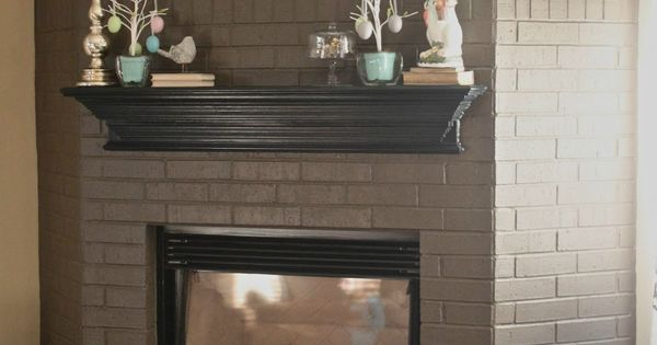 Chocolate painted brick fireplace