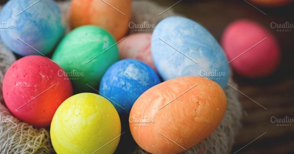 Traditional Easter eggs in a nest and rustic wood. Vintage style