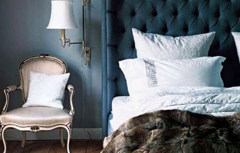 Master bedroom: gorgeous Blue tufted headboard and faux fur throw