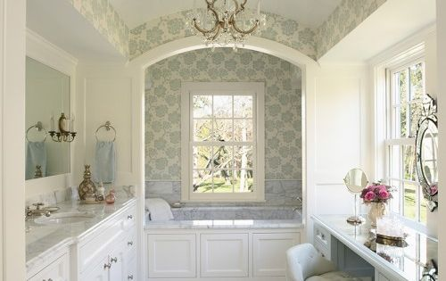 Beautiful bathroom with arched ceilings and lots of windows allowing in natural