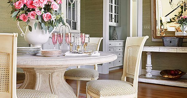 A stone pedestal table anchors the pretty in pink dining for Home zone wallpaper birmingham